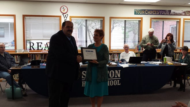 Dale Sunderman received the Jack Adams award from North Santiam School District Chair Tass Morrison.