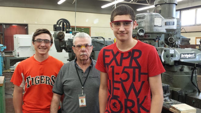 East Brunswick Tech sophomores Vince Pellicane of New Brunswick, left, and Dan Rachkelyuk of South River were guided by their teacher Ron Bodnar, center, in making parts for the State Police Bomb Squad.