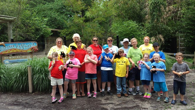 In this June 15, 2015 photo, elementary students at Ewell School on offshore Smith Island get the VIP treatment at the Salisbury Zoo. Students were randomly picked for a special day at the zoological park, where they petted animals, saw displays and had a picnic lunch.