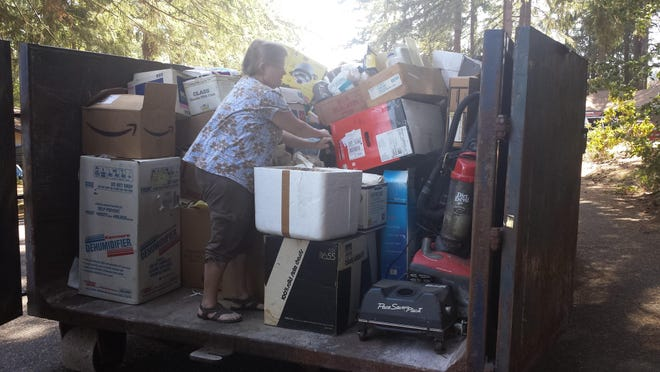 Jamie Chamberlin of Scio assists with clean-up of the Chamberlin home in Stayton.
