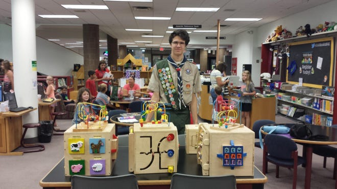 Evan Zobel, a 17-year-old Eagle Scout candidate (Troop 1539) created four unique activity cubes and three latch boxes for the Livonia libraries.