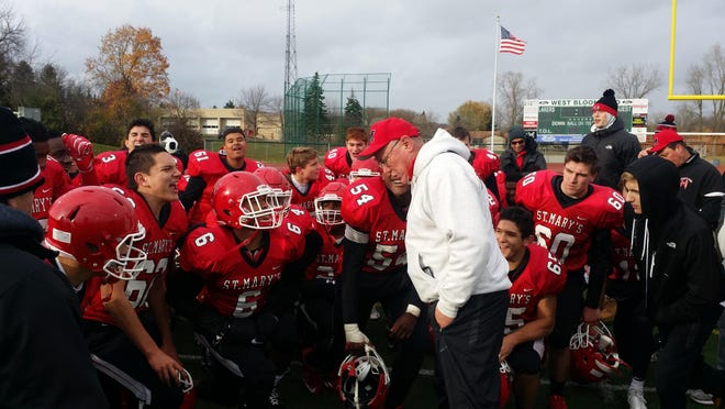 Orchard Lake St. Mary's coach George Porritt addresses his team following a 49-7 win over Dearborn Divine Child in a Div. 3 semifinal Saturday, Nov. 19, 2016.