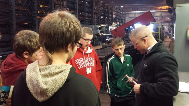 Traeger students learn how to read digital measuring devices.