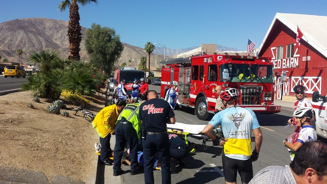 Emergency personnel respond to to a bicycle-vehicle crash in Palm Desert on Oct. 18.