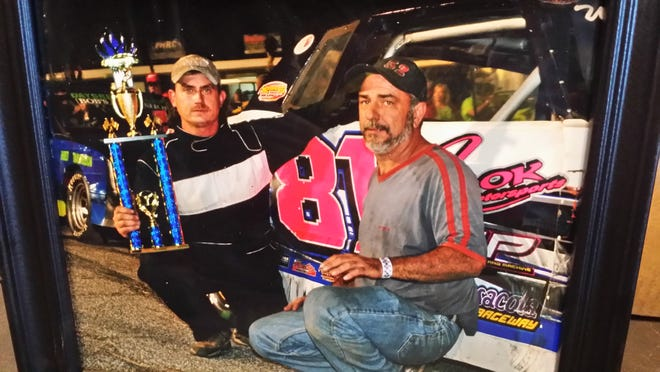 Greg Janes, right, owner and lead mechanic of Pensacola Racing Fabricators, has helped area race car drivers like Milton resident Shanna Ard, who won the 2014 Sportsman points championship at Five Flags Speedway and will be racing Thursday night in Sportsman feature during Snowball Derby week.