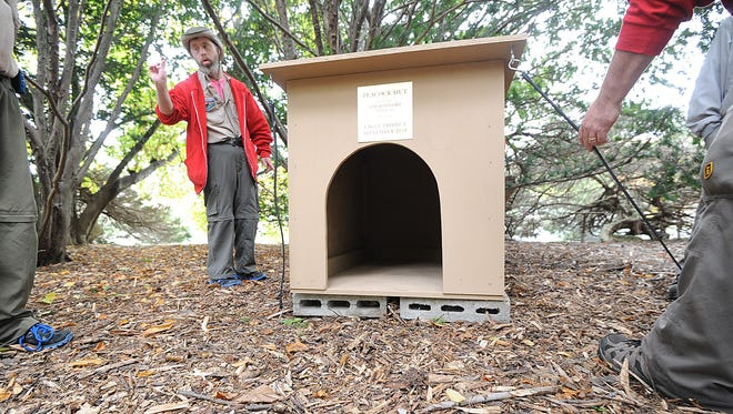 Tim Bottorf helps with the installation of the peacock house he helped build for the birds at Kingwood.