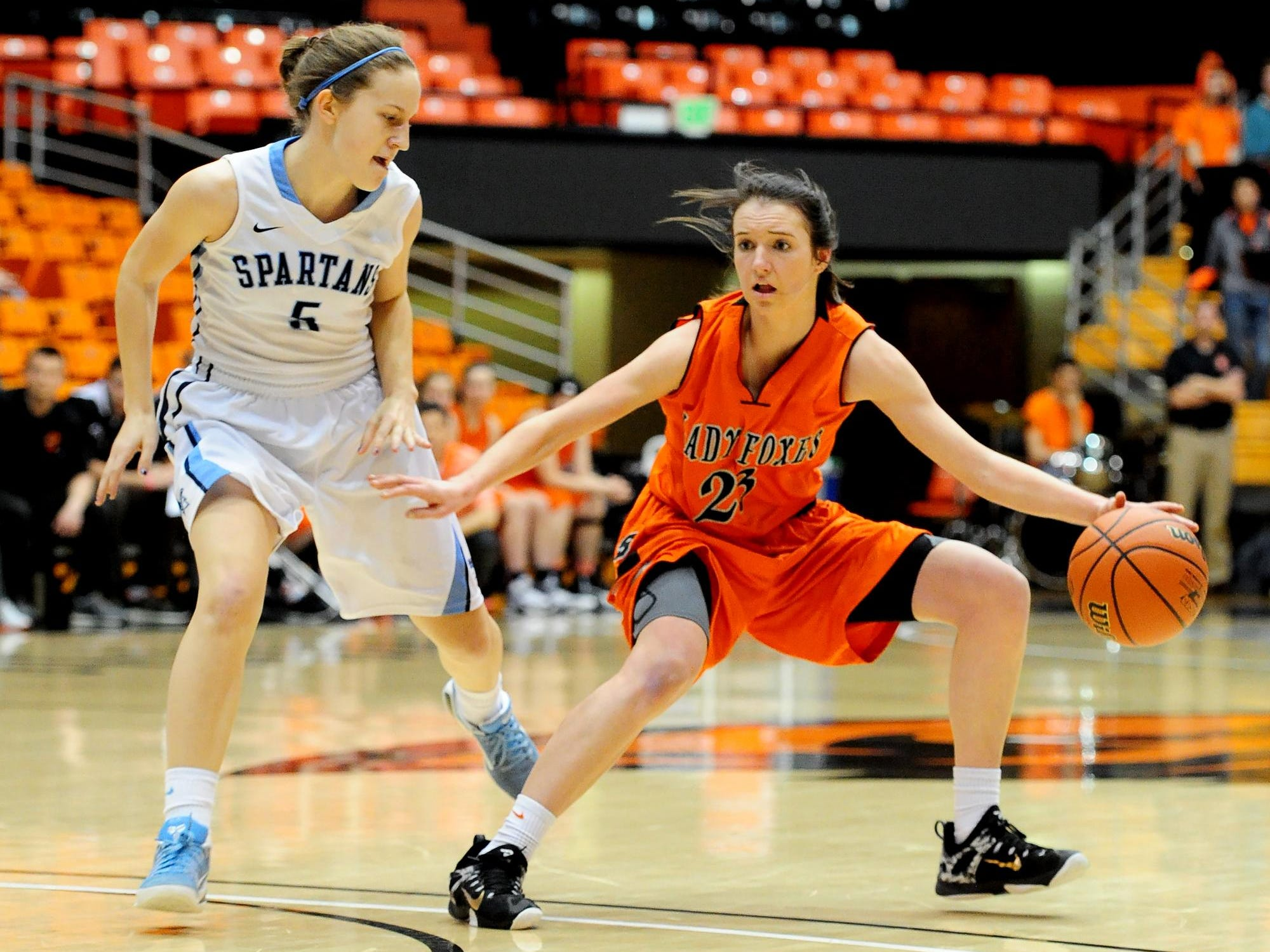Silverton's Alia Parsons controls the ball as Corvallis post Stephanie Vallancey-Martinson pressures during the quarterfinals of the OSAA Class 5A state basketball tournament at Gill Coliseum, on Wednesday, March 11, 2015, in Corvallis. Silverton loses to Corvallis 41-40.