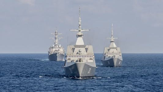 The destroyer Lassen, left, and the Singapore navy frigates Supreme, center, and Intrepid trail the U.S. littoral combat ship Fort Worth through the South China Sea in July during Cooperation Afloat Readiness and Training Singapore 2015.