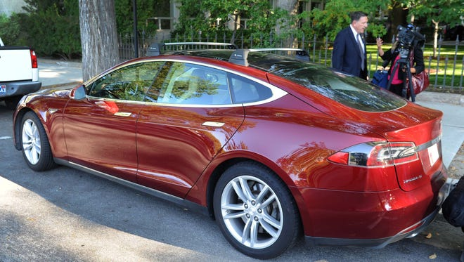 Tesla cars were lined up adjacent to the Capitol Thursday during the Tesla gigafactory announcement in Carson City.