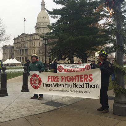 Police and firefighters demonstrate outside the Capitol