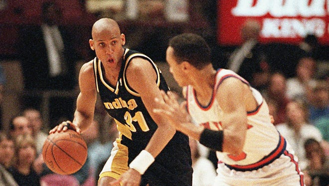 Indiana Pacers guard Reggie Miller, left, brings the ball down court while covered by New York Knicks guard John Starks during the first half of their NBA Eastern Conference Semifinals playoff game at New York's Madison Square Garden Sunday, May 7, 1995. Miller's eight points in the last eighteen seconds of the game brought the Pacers from behind to win 107-105. (AP Photo/L.M. Otero)