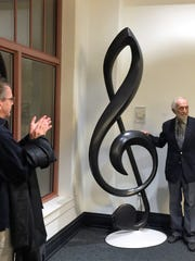 Treble Clef –  Oakland City artist Bob Zasadny saw the dedication of his delightful sculpture of a Treble Clef at the Victory Theatre. Nine feet tall, this sculpture weighs 125 pounds and took 200 hours to design, build and install. The inspiration for this marvelous piece was the clef sign on the cover of the Evansville Philharmonic's concert program. In the photo are Mayor Lloyd Winnecke at the dedication with Bob Zasadny.