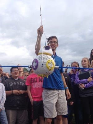 "Berryville Middle School Teacher Andrew Killingsworth prepares to launch ""BB16"", a science experiment the school conducted Thursday. The device was attached to a weather balloon that traveled to the Twin Lakes Area. The project was thought to be lost at one point before being recovered near Clarkridge."