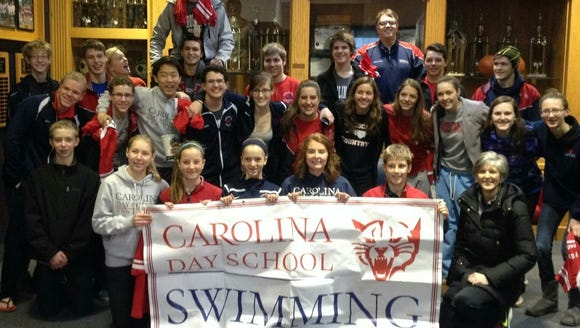 The Carolina Day swimming teams.