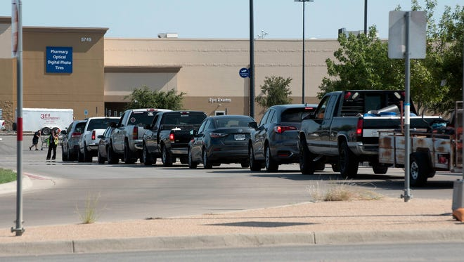 A line of cars waits for their turn at the pump after fears of a gasoline shortage caused many to top off their tanks Thursday, AUgust 31, 2017.
