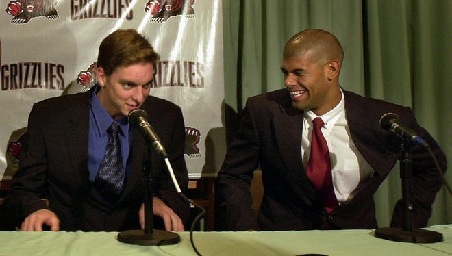 Grizzlies 2001 draft picks Pau Gasol, left, and Shane Battier are introduced to the media. Gasol, a six-time all-star who spent six-plus seasons with the Grizzlies, has a career scoring average of 17.4. Battier, who had two stints with Memphis, averaged a career-high 14.4 points per game during his rookie season. Gasol was the third overall pick by the Atlanta Hawks, but his rights were traded to the Grizzlies. Battier was the sixth overall selection that year.