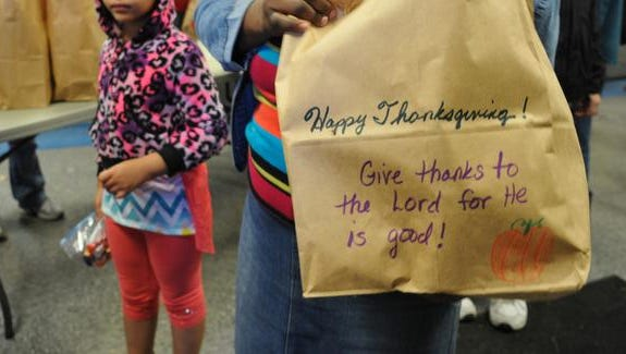 An estimated 2,000 people turned out at House of Hope on Monday for the several hours of free Thanksgiving meals for people to take home for the holidays. House of Hope Food & Clothing Ministry is cooperative of several area churches, and is located at 330 Magnolia Avenue in Merritt Island.