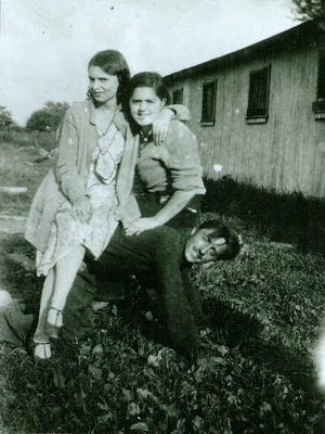 Katie Attaldo Farina, right, with her sister and brother; Farina is Carly Fox's grandmother.