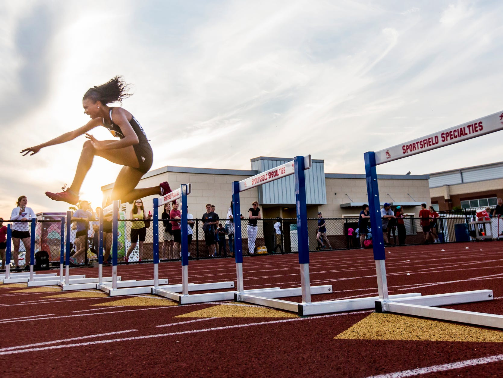 Padua's Taliah Cintron leaps a hurdle on her way to a first place finish in the Girls 300 Meter Hurdles event at the Meet of Champions at Dover High School on Wednesday evening.