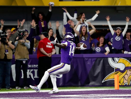 CORRECTS SPELLING TO DIGGS NOT RIGGS Minnesota Vikings wide receiver Stefon Diggs (14) runs in for a game winning touchdown against the New Orleans Saints during the second half of an NFL divisional football playoff game in Minneapolis, Sunday, Jan. 14, 2018. The Vikings defeated the Saints 29-24. (AP Photo/Jeff Roberson)