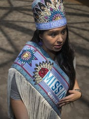 Miss Indian World Danielle Ta'Sheena Finn stands in ASU's Armstrong Hall, home of the law school, in Tempe on May 9, 2016.