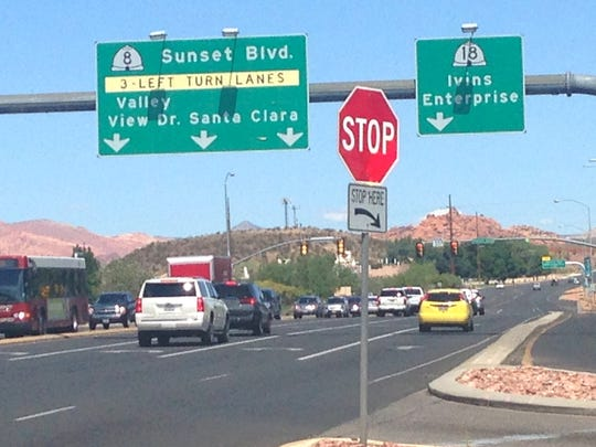 Motorists negotiate the intersection of Bluff Street and Sunset Boulevard in St. George on Monday, Aug. 31, 2015. State traffic managers are planning to overhaul the intersection as part of a larger effort to improve a one-mile stretch of the Bluff Street corridor.