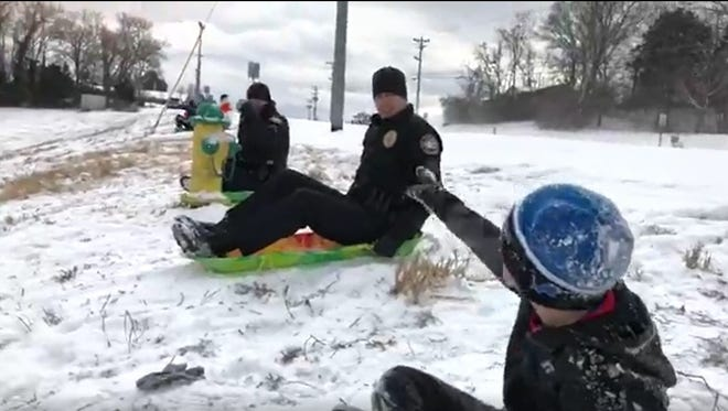 Mt. Juliet police officers sled with a youth Tuesday, Jan. 16, 2018.
