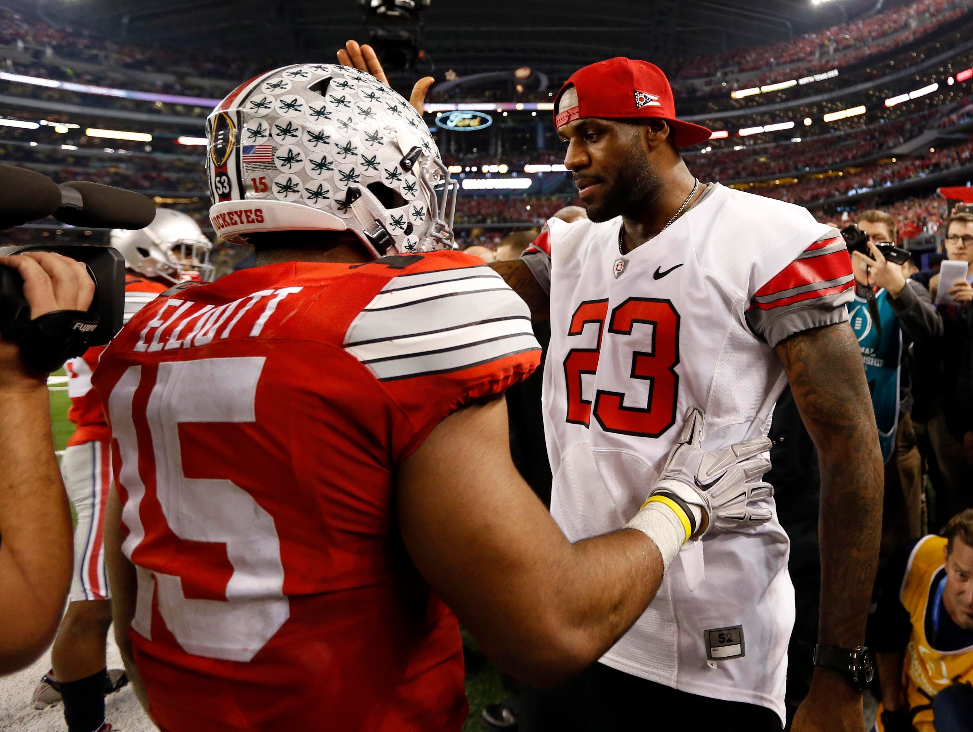 Ohio State Buckeyes running back Ezekiel Elliott (15) greets Cleveland  Cavaliers player LeBron James a4870d9d5