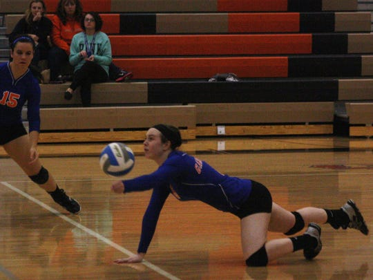 Garden City's Holly Sayger went horizontal to record a third-set dig Thursday night.