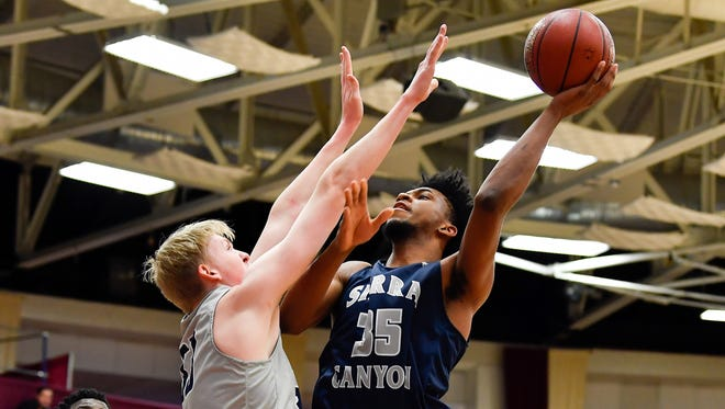 Sierra Canyon School Trailblazers player Marvin Bagley III (35) and La Lumiere School Lakers player Jacob Epperson (33) at Blake Arena.