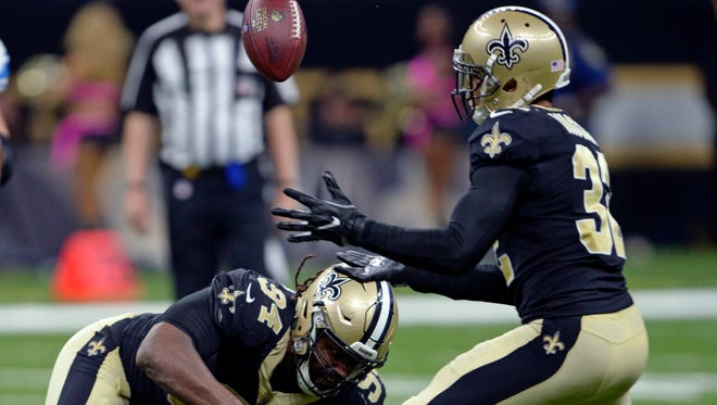 New Orleans Saints defensive end Cameron Jordan (94) forces Detroit Lions running back Theo Riddick (25) to to lose the football on a pass play, as Saints strong safety Kenny Vaccaro (32) intercepts in the second half of an NFL football game in New Orleans, Sunday, Oct. 15, 2017.