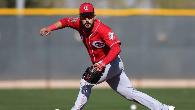 Cincinnati Reds third baseman Eugenio Suarez (7) eyes a groundball, Tuesday, Feb. 20, 2018, at the Cincinnati Reds Spring Training facility in Goodyear, Arizona.