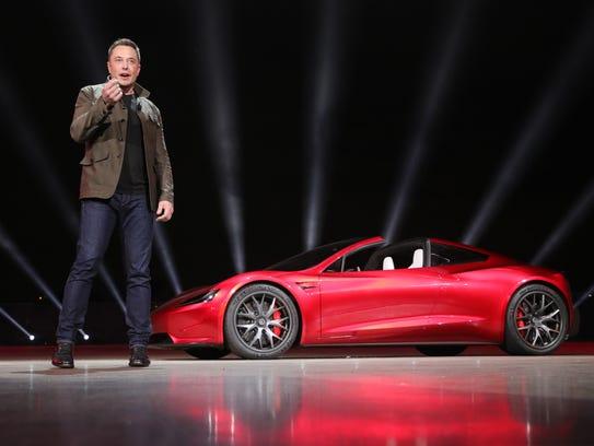 Tesla founder Elon Musk presenting the new Roadster