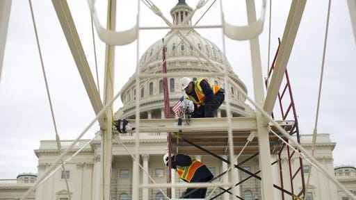 Construction continued Dec. 8 on the inauguration platform in preparation for the swearing-in of President-elect Donald Trump on the Capitol steps in Washington. Trump's Presidential Inaugural Committee has raised a record $90 million-plus in private donations.