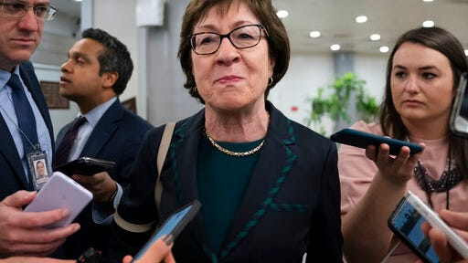 FILE - In this Feb. 12, 2020 file photo, Sen. Susan Collins, R-Maine, pauses for reporters following a vote, at the Capitol in Washington.   President George W. Bush is endorsing Republican Sen. Susan Collins in his first public endorsement of the 2020 election cycle.