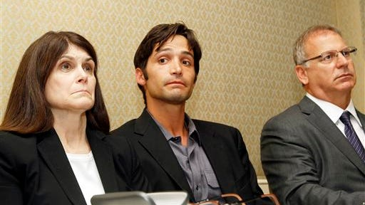 In this file photo, plaintiff Michael Egan III, center, 31, his mother Bonnie Mound, left, and attorney Jeff Herman take questions from the media during a news conference in Beverly Hills, Calif. Garth Ancier filed a malicious prosecution lawsuit on Friday, June 27, 2014, against Egan and two lawyers who filed the sex abuse lawsuit on his behalf. Ancier, who has been a high-level executive for NBC, Fox and other television networks, states in his lawsuit that Egan knew his abuse claims were false and the case never should have been filed.