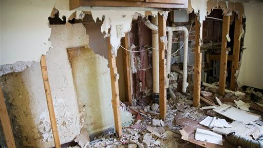 """This photo shows damage to the kitchen of Rosa Parks' landmark home in Montgomery, Ala. """"Vandals came in and pilfered it. They went in and tore out the walls and they stole the copper pipes and pretty much destroyed the apartment,"""" said Evette Hester, executive director of the Montgomery Housing Authority."""