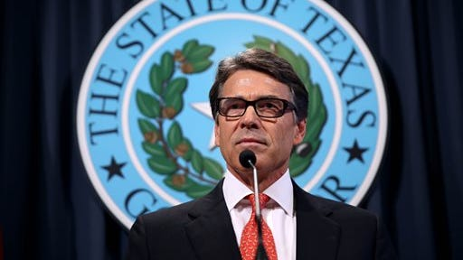 Gov. Rick Perry makes a statement at the capitol building in Austin, Texas on Saturday, Aug. 16, 2014 concerning the indictment on charges of coercion of a public servant and abuse of his official capacity.