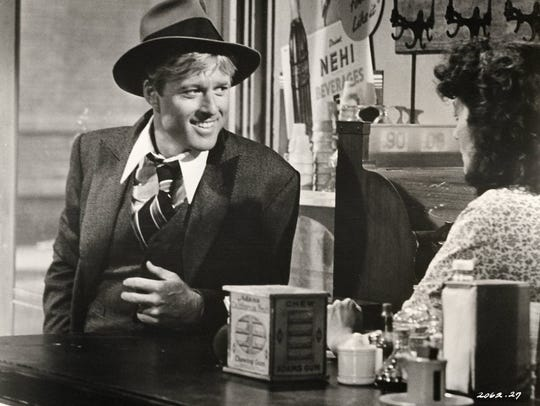 "Robert Redford and Dimitra Arliss in ""The Sting."""
