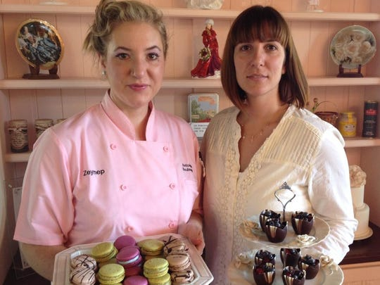Sisters Zeynep Ozdemir (left) and Ayca User, owners of Antoinette Boulangerie in Red Bank, hold some of their French pastries.