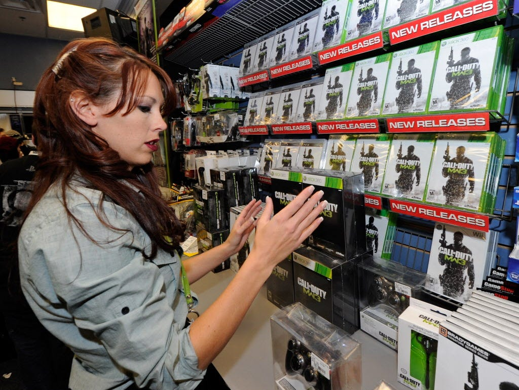 ORG XMIT: 131672750 NORTH LAS VEGAS, NV - NOVEMBER 07:  GameStop employee Randi Taber stacks copies of