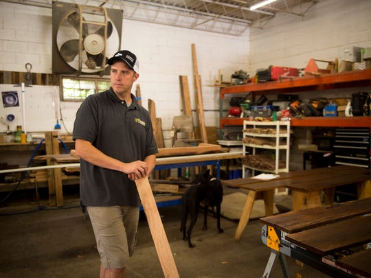 Smoky Mountain Vintage Lumber owner Andrew Edens stands