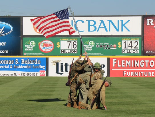 A re-enactment of the flag-raising at Iwo Jima will