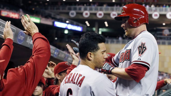 The Diamondbacks' Mark Trumbo is greeted in the dugout after his two-run home run against the Twins on Monday in Minneapolis.