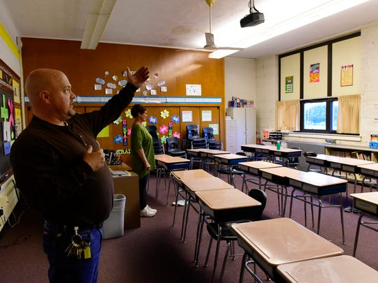 Don Jacobs, maintenance worker with Fremont City Schools shows a classroom at Croghan Elementary