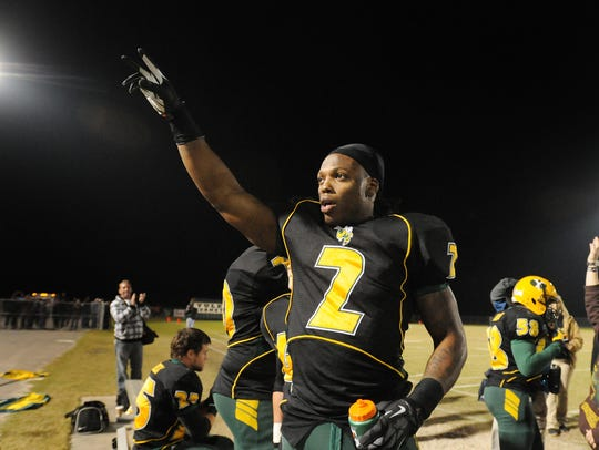 Yulee's Derrick Henry (2) acknowledges the crowd after his record-setting touchdown run during the Region 1-4A semifinals Nov. 16, 2012.