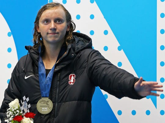 Katie Ledecky reacts after winning the womenÕs 800m
