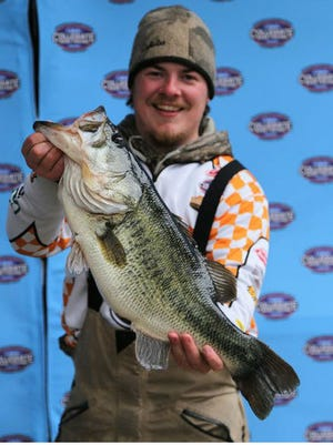 Vols angler Scott Ellis, who is from Madison, shows off the 9.64-pound largemouth that helped him win the Texas Lunker Challenge on Sam Rayburn Reservoir in Texas on Sunday.