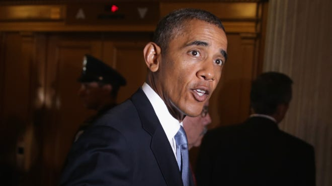 President Barack Obama leaves a policy luncheon after meeting with Senate Republicans at the U.S. Capitol on Tuesday.