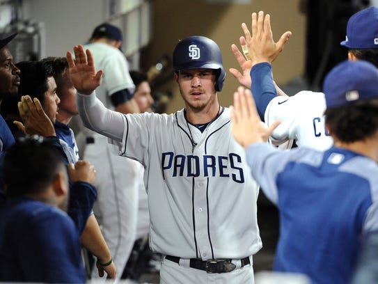 Wil Myers is congratulated by teammates in the Padres